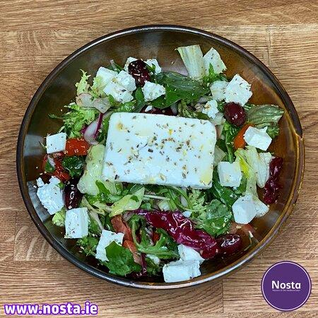Greek Feta Salad (V) 2 Mixed leaves, cherry tomatoes, red onion, feta cheese, olives & dressing.