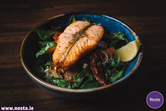 Grilled Salmon Salad  Chargrilled salmon strips on a bed of seasonal salad & dressing.
