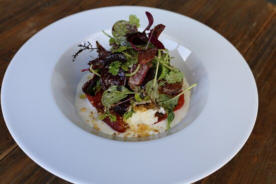 Roasted marinated tomatoes, parmesan cream, sliver of goat cheese, fried corn and leaves