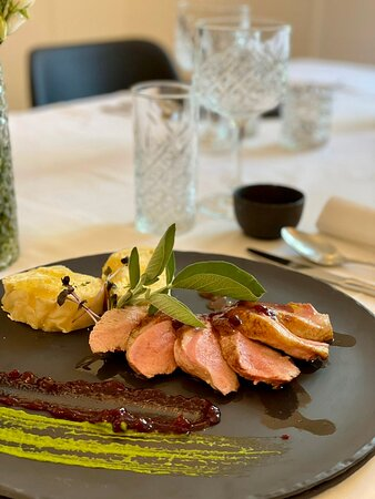 Sauteed duck breast in cranberry sauce with homemade cheese štruklji