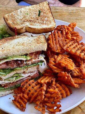 Turkey club with sweet potato fries & Chicken & waffles with fries