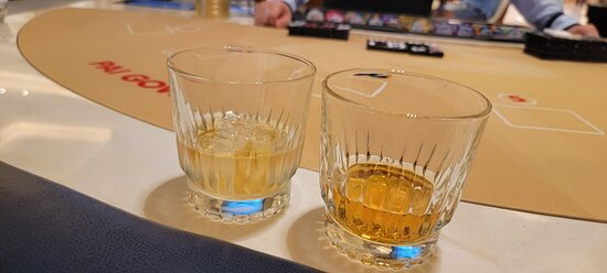 Drink on left is how it was served.  Its a whiskey on the rocks.  When I asked for a full drink, they brought the one on the right without ice.