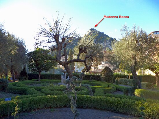 Photo shot inside the Public Garden of Taormina built by Lady Florence where during the summer the shadow of pine grove and fresh air come from sea make feel a few of refresh. Here we are in main entrance long Via Roma. https://www.taobook.co.uk/taormina-public-garden-naturalistic-tour/