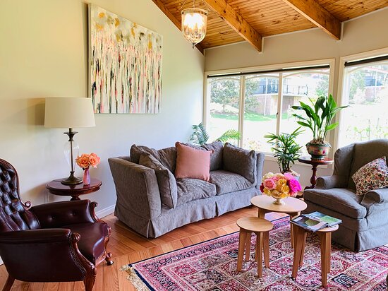 Guest sunroom in The Lodge with beautiful views of the property garden