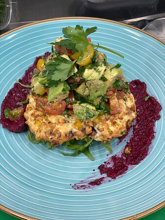 House-made corn fritter with roast beetroot pure and tomato and avocado salsa