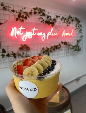 Passionfruit smoothie bowl topped with fresh fruit & granola of your choice