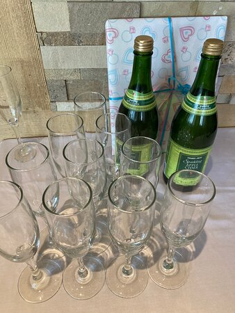 Toast glasses and beverage on side table