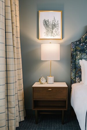 The Bradley Deluxe Room. Ranging from 278 to 303 square-feet of space, our Deluxe King and Double Queen rooms are brimming with Midwestern charm and sophisticated accents that make one feel right at home.