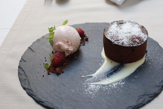 Chocolate soufflé with raspberry ice cream