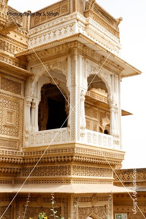 """Front close up upper floor....Pillars ,walls , beams, Jarokha's / Windows with seamless patterns, geographic & gematrical patterns combinations , everywhere seen superb carvings on sandstone, beautifully crafted sculptures and fantastic carved domes. The all side walls carry the intricate Jali or lattice work in stone in very large scale with different seamless patterns combination..... """"Amar Sagar Jain Temple"""" ,Jaisalmer, Rajasthan , India ."""