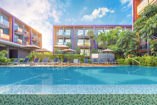Signature Outdoor Swimming Pool with sunbathing area