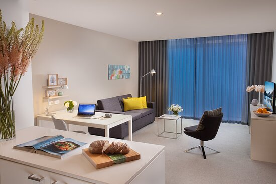 One Bedroom Deluxe Kitchenette and Living Area