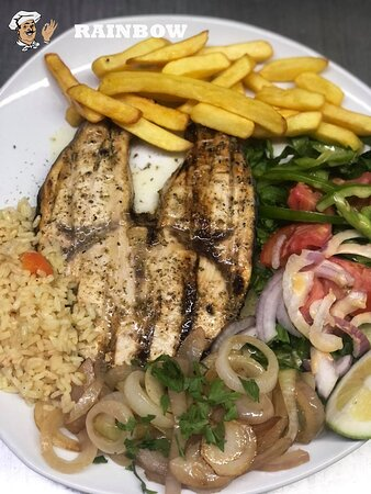 Grilled Swordfish Fillet from our Seafood Menu.  Served with rice, fries, mixed salad and herb garnish.  Full menu can be found on: https://www.therainbowtaverna.co.uk/menu