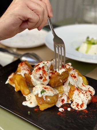 Naxos Potatoes : triple cooked / Monemvasia goat cheese / black truffle aroma / smoked paprika