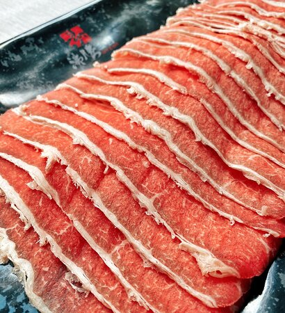 Sliced beef ( to be cooked in the soup base)