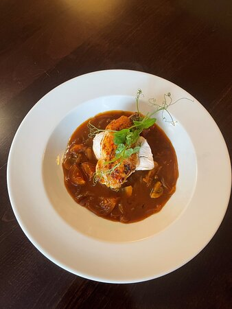 Roast chicken breast served with a Chasseur sauce, green vegetables and gratin potatoes