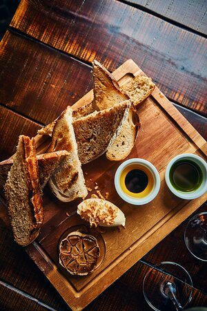 Artisan Bread & Oils -- A selection of warm breads, house churned salted butter, oils and aged balsamic