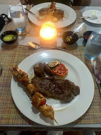 We did a oceanside candlelight dinner at the Steakhouse. The steak was ok, but the chicken & shrimp skewers were delicious.