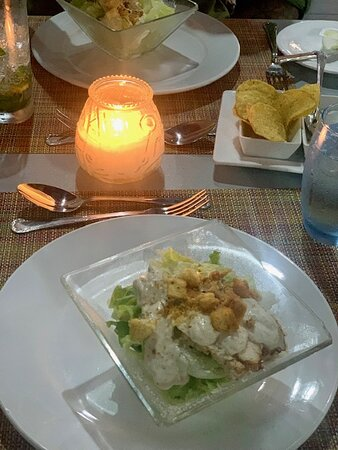 Caesar salad over a beautiful oceanside candlelight dinner at the Steakhouse.