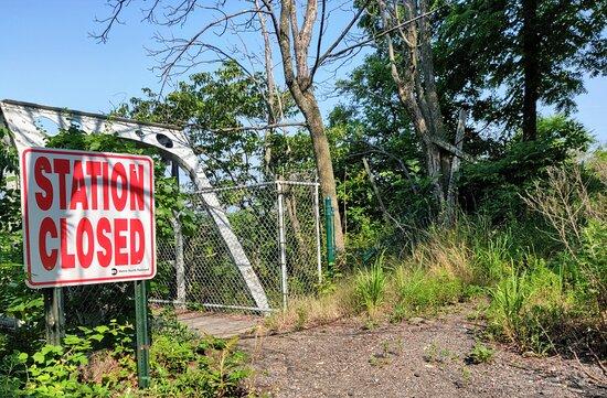 Sign on rail trestle.