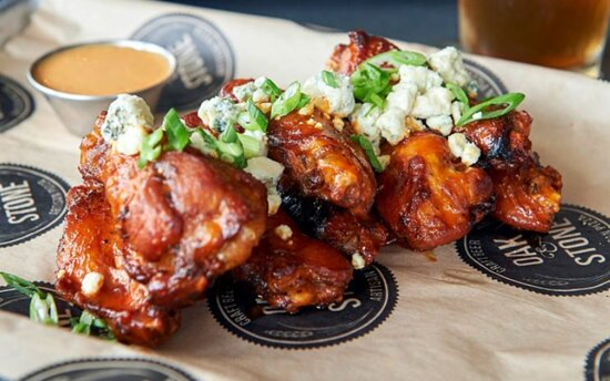 A HOMETOWN FAVORITE! Soaked overnight in a secret brine, slow roasted in the oven, topped with our signature wing sauce and bleu cheese crumbles.
