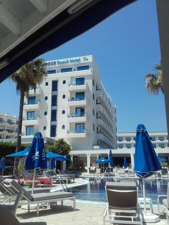 A view to the front face of the hotel from the small Tavern near pool