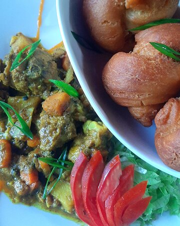 Curry goat with a side order of festivals. An old time favorite!