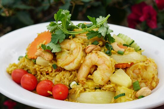 Pineapple Fried Rice - Stir fried rice with egg, pineapple, cashew nuts, onion, carrots, curry powder
