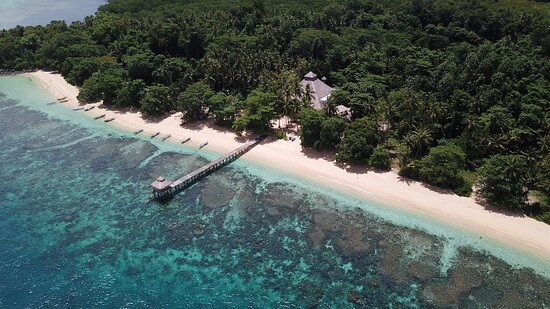 Coral Eye jetty & main building on our private beach