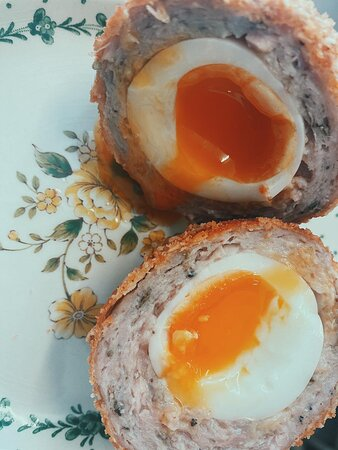 Yes - Scotch eggs are on the menu! served warm with a runny yolk.