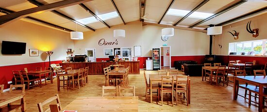 Oscar's Café - Spacious and well ventilated café seating area complete with log burner for those chilly winter days.