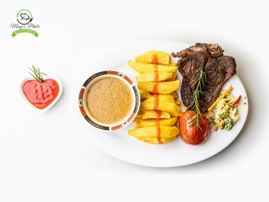 Tender Grilled T-Bone Steak.  The T-Bone Steak is well marinated to make it juicy, grilled on open flames for a smokey grilled taste, and cooked to perfection to make it soft and tender.  This dish is served with Chips or Ugali and a salad.