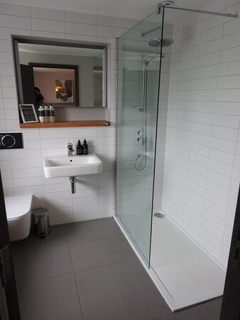 Our spacious family room bathroom with walk in shower