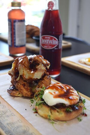 Chicken & the Egg  Hand Breaded Chicken Tenders, Aged White Cheddar, Poached Egg, Microgreens, Chipotle Cheerwine Sauce, served on Southern Buttermilk Biscuit