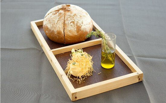Homemade bread with olive oil and butter.