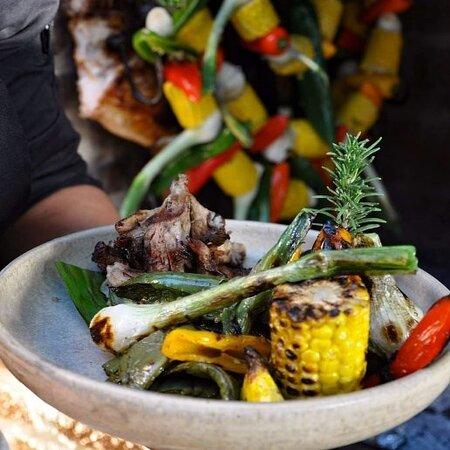 """Thursday night, during the #artwalk enjoy our """"Piggy Thursday""""! We'll prepare a Mexican style piglet accompanied by an homemade gravy, organic vegetables, cambray potatoes, homemade blue corn tortillas and grilled pineapple! 🐖🍍  Jueves por la noche, durante el """"artwalk"""" disfruta nuestro """"Jueves de Lechon""""! Prepararemos un lechón a la cruz acompañado de salsa gravy casera, vegetales orgánicos, papas cambray, tortillas de maíz azul caseras y piña asada! 🐖🍍"""