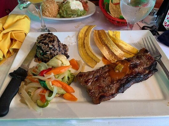 Steak medium rare with roasted veggies, plantains and rice & beans! Simple but delicious!
