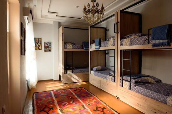 8 dorm beds mixed room with private bathroom.