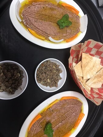 Meat Grape leaves in the preparation stage! Customers enjoying our Meza Plate and Stuffed Eggplant, Lafayette international tour is also here. At Tabouleh Lebanese Cuisine. Lafayette Louisiana. Come join us for a great Meal and atmosphere!!