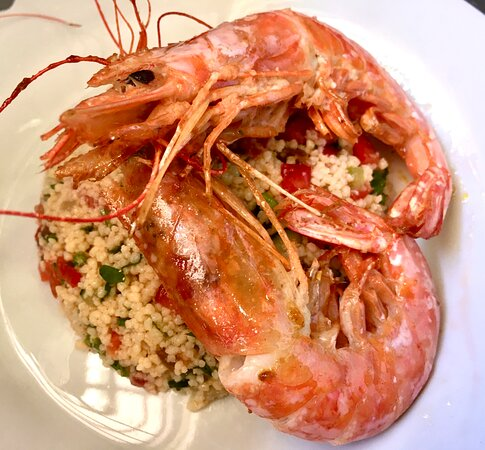 Cous cous with grilled prawns… perfect for summer with a delicious glass of one of our chilled white wines