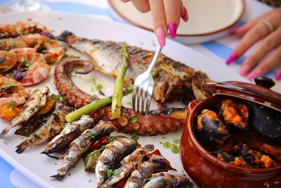 Seafood Platter for 2 people ( Fish of Day, Grilled Octopus, Grilled Shrimp, Sardines, Grilled Squid, Saganaki Mussels, Grilled Vegetables).
