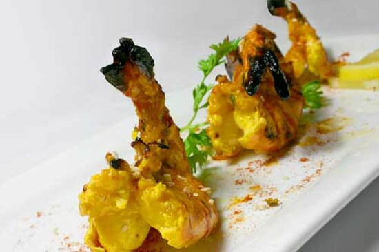 BBQ jumbo prawn cooked with lemongrass and indian spices.