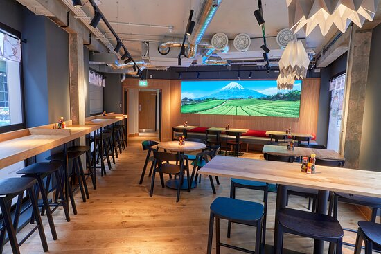 Walk through to the Kagawa room at the front of the restaurant and take control of the scenery from your phone by choosing the backdrop on the giant screen!