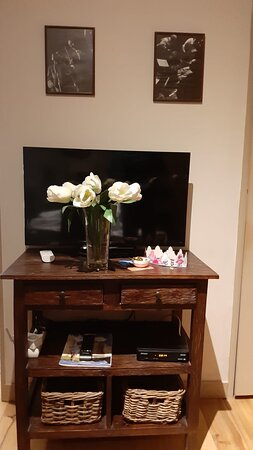 Table with TV and amenities.