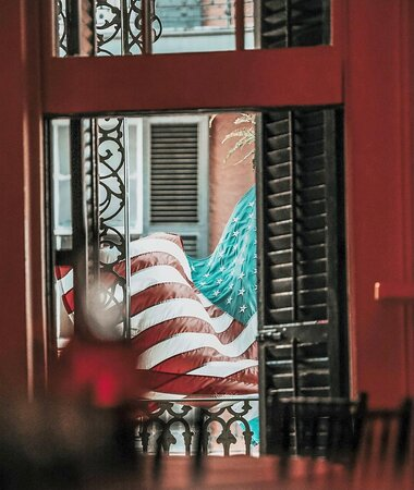 American Flag on Balcony from inside the Twelfth Night Private Dining Room.