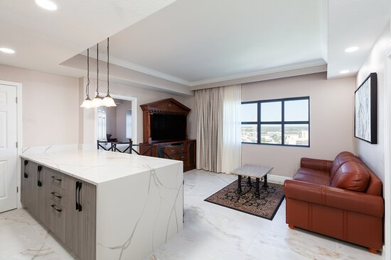 The Signature Two-Bedroom Deluxe Villa features a queen bed in the master bedroom, two twin beds in the second bedroom, kitchen with dining area, and fully equipped kitchen.