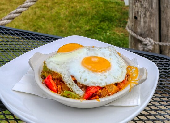 RDG Skillet - Fried potatoes topped with tomatoes, onion, green pepper, chorizo/beef, Monterey jack cheese, eggs, cilantro lime sauce and pico de gallo.