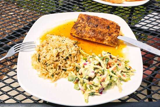 Mahi Mahi - Lightly blackened Mahi filet grilled and finished with our spicy honey mango sauce and served over cilantro lime rice and brussel sprout slaw.