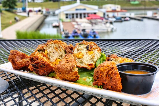 Corn and Poblano Fritters - Savory fritters loaded with corn and poblano peppers served with a sweet and spicy mango honey sauce.