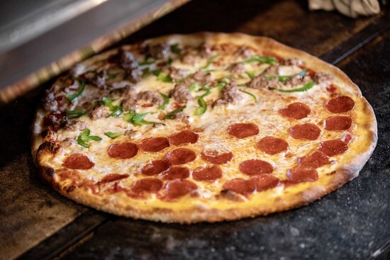 Who say's you have to agree on toppings when you can split it! Photo: Justin Huard